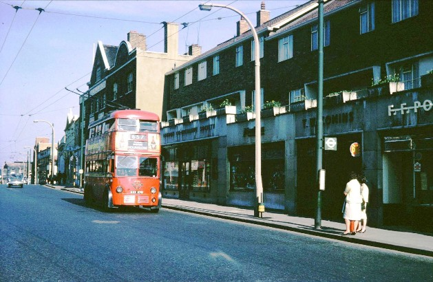 Red trolleybus no. 657 heading towards Hounslow