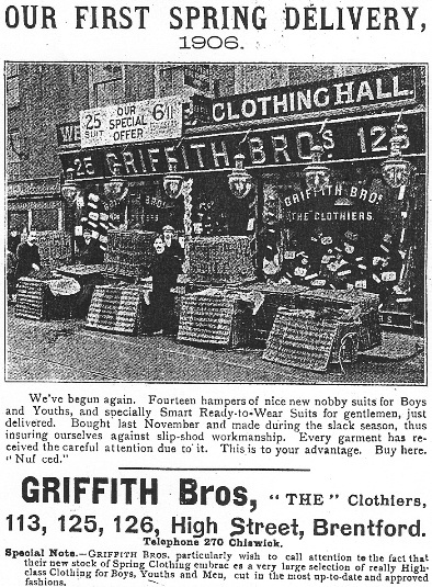 Photo taken outside the shop in 1906 showing 'fourteen hampers of nice new nobby suits for Boys and Youths'