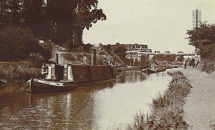 View of canal with barge and other boats