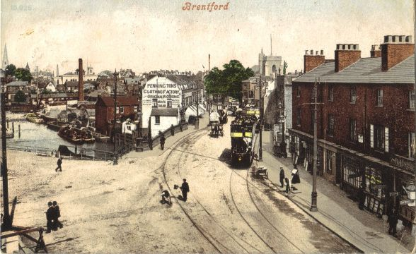Tinted view of busy street with wharves in background