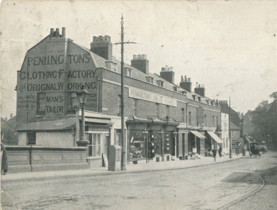 Penningtons and other shops by Brentford Bridge