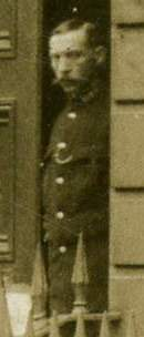 Policeman standing in doorway