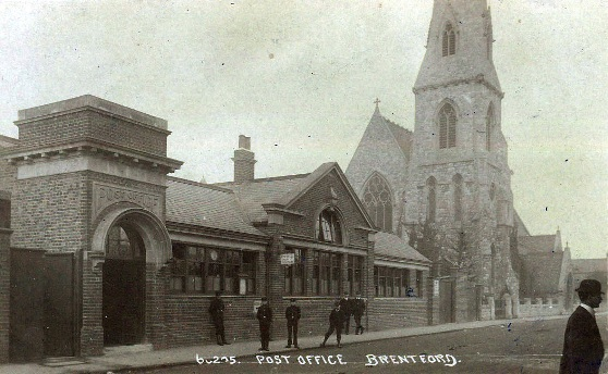 Post Office: brick building with 6 young male postal workers outside, also St Paul's church