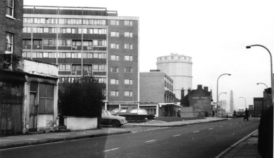 Black & white photo, view of a rectangular block of flats