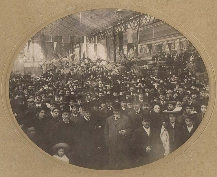 Market hall interior with several hundred people