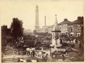 Market carts parked round the fountain at Kew Bridge (either 1892 or early 1893); image provided by Chiswick Public Library