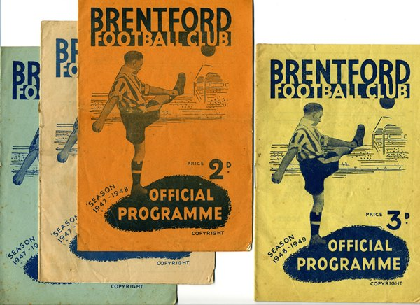 Four BFC programme covers each with the same image of a footballer kicking a ball