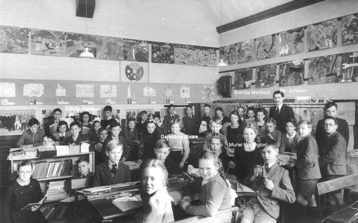 Classroom scene, nearly 40 pupils and their form teacher