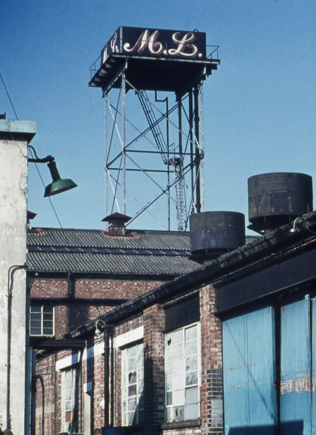 Factory view with signage 'M L' on a roof tower