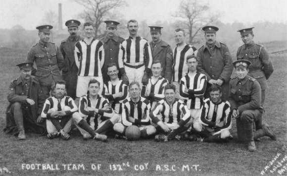 Football team and men in army uniform
