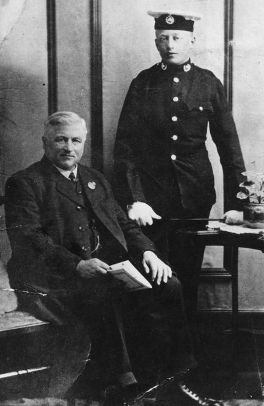 Thomas Knight seated, his son Tom in uniform, standing