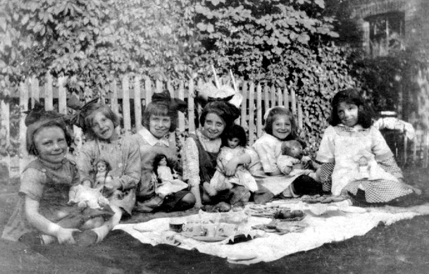 6 small girls at outdoor tea party