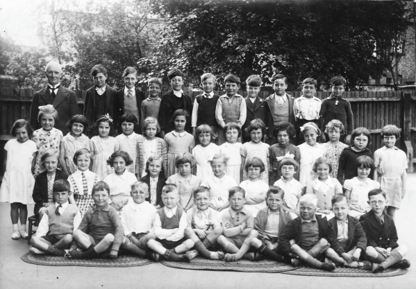 Schoolmaster with 45 children