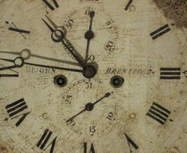 Clockface, showing 'Upjohn Brentford'